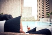 Person-holding-drink-by-the-pool-in-Dallas