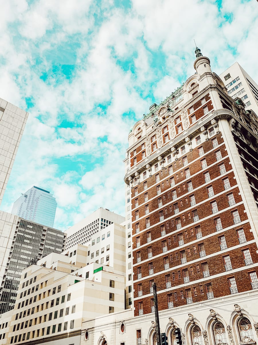view of Adolphus hotel outside looking up at skyline